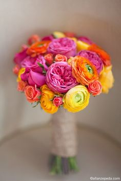 pink orange and yellow bouquet, spray rose cabbage rose and ranunculus bouquet