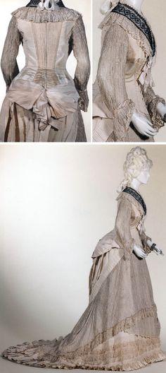 Dress, Brussels, 1877. Cream silk faille with cream & black lace. Musées Royaux d'Art et d'Histoire via kikirpa.be/