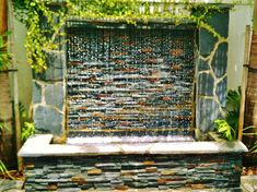 Waterwall Fountain by enviroscapela.com designed and installed by Mike Garcia, Founder of Enviroscape LA in Manhattan Beach, California  Los Angeles backyard paradise. #enviroscapela #landscaping #redondobeach