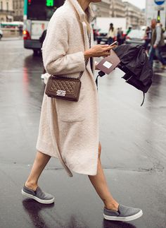 The look of a beautiful overcoat with tomboy sneaker make for an effortless vibe.