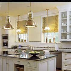 Industrial lights in a white kitchen