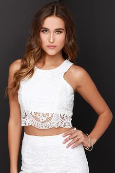 Get into double the trouble, and have twice the fun with the Double Time Ivory Lace Two-Piece Dress! Stunning crocheted floral lace covers a sleeveless crop top with rounded neckline, and figure-enhancing princess seams. The matching midi-length pencil skirt completes the look with a body-skimming fit, and band of sheer lace at bottom. Top and skirt have exposed gunmetal back zippers.