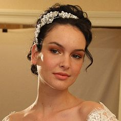 Brides: The Best of Runway Beauty. At Claire Pettibone, a rhinestone- and pearl-bedecked headband glams up a lacy, off-the-shoulder gown straight from the pages of a Jane Austen novel.