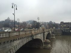 Bridge over the Po river - by TravEllenineurope.com