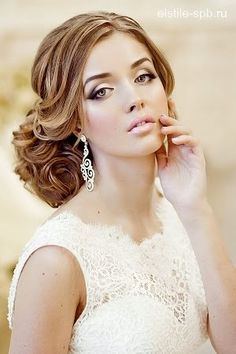 Romantic wedding hairstyle and makeup