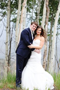 The bride and groom in the romantic Colorado woods | @jennawphotog | Brides.com
