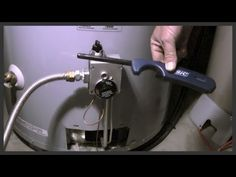 How to relight a water heater pilot light - YouTube
