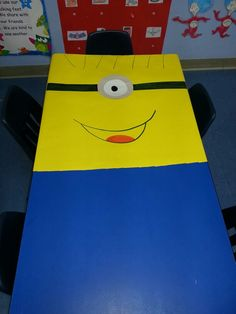 This could be the classroom door with minion tags on a board/wall next to it.