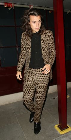 Not only does Harry Styles provoke hysteria from the millennial generation wherever he goes, the One Direction singer is also a blank canvas for designers, refining his style with every season. See him dressed by his favorite designers from Saint Laurent by Hedi Slimane to Gucci and Calvin Klein, in our Harry Styles look book.