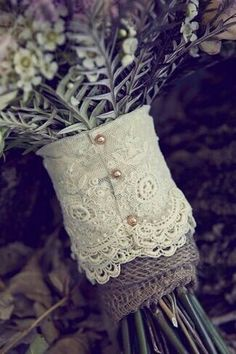 A Lacey cuff around a vase of flowers l wedding bouquet