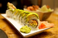 My Green Dragon Maki: Tempura Shrimp, flying fish roe, and cucumber topped with avocado.