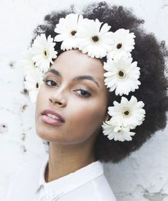 flowers in afro. I would do one or two on the side of my head though. She is so pretty!