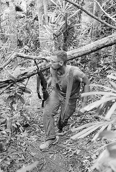 BE020211      29 Aug 1966, Da Nang, Vietnam --- A marine at a command post runs for cover as snipers open fire on August 26, 1966. --- Image by © Bettmann/CORBIS