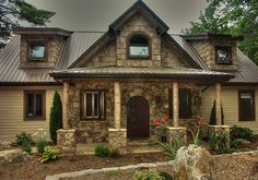 Mountain rustic home, natural stone, poplar bark accents with hardiboard siding - by Moore Construction Services