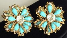 This pair is beautifully crafted in a floral design with lovely turquoise blue stones for the petals and glittering brilliantly clear rhinestones for the centers. They are clip on style. The condition of these gorgeous earrings is very good. Vintage Costume Jewelry, Vintage Jewelry, Pierre Decorative, Design Floral, Miriam Haskell, Bleu Turquoise, Vintage Earrings, Etsy Earrings, Turquoise Bracelet