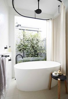 modern bathtub shower combination with oval tub and large window Modern Bathtub, Modern Bathroom, Small Bathroom, Bathroom Tubs, Paint Bathroom, White Bathrooms, Bathroom Fixtures, Bathroom Showers, Lake Bathroom