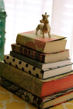 DIY re-purpose books wrapped in fabric and paper. Easy and inexpensive way to use books as accessories and create a statement. Design by The Black Goose Design.