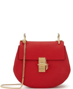 Shop now. Chloé Drew Mini Saddle Bag. Elegant in softly grained lipstick red leather, this miniature version of Chloé's iconic Drew bag marries glamour with sophistication. The minimalist design features a perfectly sized card slot in the dove grey suede interior and premium polished gold-toned hardware. A medium-weight, removable cross-body strap is a perfectly Parisienne-style finish to this piece of chic French design.