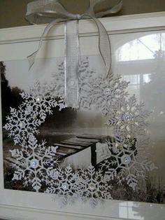 Glue together snow flake ornaments & add bow..