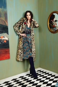 Who wears blue suede boots?! You do! This knee-length leopard coat with crochet flower appliqué detail is the fur coat of your dreams!  #aliceandolivia #aofall16