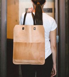 Sleek yet practical, this leather bag has two styles in one.
