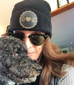Happy customer wearing her custom fold up cashmere beanie with our exclusive peace love paw leather patch by Hippy Spirit