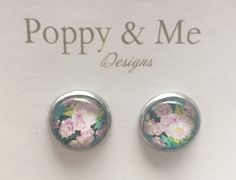 A personal favourite from my Etsy shop https://www.etsy.com/au/listing/496435557/floral-pinks-and-green-glass-cabochon