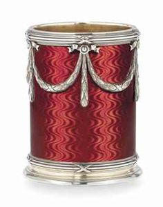 A SILVER-GILT GUILLOCHÉ ENAMEL MINIATURE VASE BY FABERGÉ WITH THE IMPERIAL WARRANT, WORKMASTER ANDERS (ANTTI) NEVALAINEN, ST PETERSBURG, 1908-1917. Cylindrical, enamelled in translucent strawberry red over a wavy guilloché ground, the sides applied with five ribbon-tied laurel swags, suspended from rosettes with ribbon crests, between ribbon-tied reeded borders.