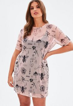 This dress features in a pink mesh hue with a tattoo print throughout and short sleeves with a crew neckline.