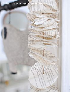 How to Make a Book Page Garland - Town & Country Living Crafts To Do, Diy Craft Projects, Arts And Crafts, Diy Crafts, Paper Gifts, Diy Paper, Paper Crafting, Book Page Garland, Book Page Crafts