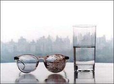 John Lennon glasses and a glass of pure water after his death. Photo concept by Yoko Ono.