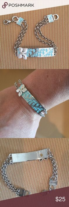 Beautiful Bracelet Pretty Tiffany blue color and silver. Bought this and maybe wore it twice. It's not sterling. I'm not sure of the metal although it's never turned or left any markings on my arm. Raised flower. Made very nicely. Jewelry Bracelets