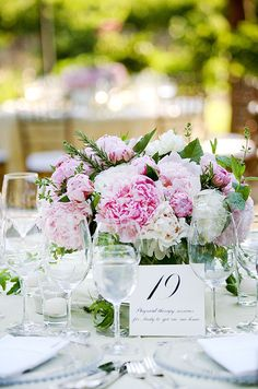 These low centerpieces with pink and white peonies are so elegant for an outdoor ceremony.