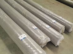 Five metal coil drapery rolls is wrapped with plastic film and pasted on labels.