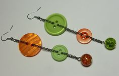 Super funky and Unique Button dangle earrings! Orange and Green Buttons with Cracked Glass beads. Asymmetrical Retro style. Silver hooks link: https://www.etsy.com/ca/listing/203432585/super-funky-and-unique-button-dangle?ref=shop_home_active_11