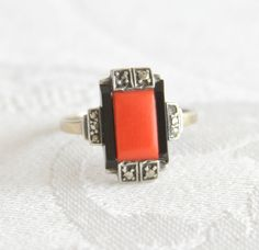 A stunning silver and gold art deco ring with a geometric design in red coral, onyx and marcasites. This could be a Theodor Fahrner ring, as it