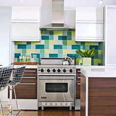 A bold backsplash adds a pop of color to this contemporary kitchen. More backsplash inspiration: http://www.bhg.com/kitchen/backsplash/find-your-perfect-kitchen-backsplash/?socsrc=bhgpin062912