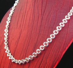 Chainmaille Rosettes Sterling Silver 18 inch Necklace by CreativeReflections on Etsy https://www.etsy.com/listing/111711349/chainmaille-rosettes-sterling-silver-18