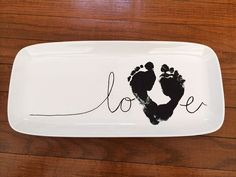 DIY a baby footprint love plate for grandparents this year. A sweet craft keepsake gift. All About Babies DIY a baby footprint love plate for grandparents this year. A sweet craft keepsake gift. Idee Cadeau Grand Parent, Cadeau Grand Parents, Baby Crafts, Crafts For Kids, Baby Footprint Crafts, Baby Footprint Tattoo, Toddler Crafts, Baby Footprints, Handprint Art