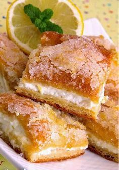 Lemon Cream Cheese Bars - Made half a recipe, used an 8x8 baking dish, and cut into 12 squares. I used reduced fat cream cheese and Splenda (cutting back on the amount in the recipe) with good results. These are an EXCELLENT dessert for any occasion... quick and tasty :)