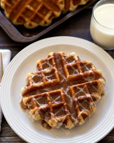 Cinnamon Roll Liege Waffles | A rich, buttery waffle with a sweet, crisp caramelized exterior served cinnamon roll style with a sweet cinnamon butter and a pretty icing drizzle.