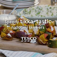 Grab a speedy veggie supper with these easy tikka-flavoured halloumi skewers. Threaded with cheese and colourful veg, they make a delicious supper ready in under 25 mins. | Tesco