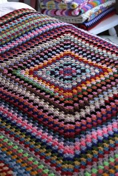 Crochet Granny Square Blankets She used up all of her scrap yarn, in a very random order, paying no mind to colour clashes or matches. Crochet Afghans, Easy Crochet Blanket, Crochet Blanket Patterns, Crochet Stitches, Crochet Cushions, Knitted Baby Blankets, Crochet Pillow, Afghan Patterns, Square Patterns