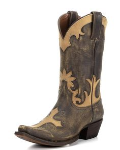 The Sasha by American Rebel flies high in vintage style. Tan overlays on top of the vintage honey leather make it essential for todays generation of Western women. In addition to the traditional cross on the toe, the floral patterns add exotic flair. Get out there with the Sasha!<br><br>Brave is beautiful. American Rebel boots are made for women who practice the art of living on the edge. Never ordinary, always stunning, a Rebel keeps faith in the wild and the free. Forever a…