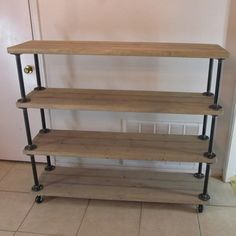 "This shelf/cart is made from reclaimed wood and steel pipe. The shelf is 54&1/2"" long X 14&1/2"" deep and 72"" tall. It has casters and corner braces on the bottom. This can be done in any stain choi..."