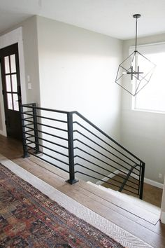 All the Details on our New Horizontal Stair Railing! is part of Metal stair railing It& hard to believe these stairs have been in limbo since March when we tore out all the carpet and hand rail in - Indoor Stair Railing, Cable Stair Railing, Black Stair Railing, Interior Stair Railing, Black Stairs, Stair Railing Design, Metal Stairs, Stair Handrail, Modern Railings For Stairs