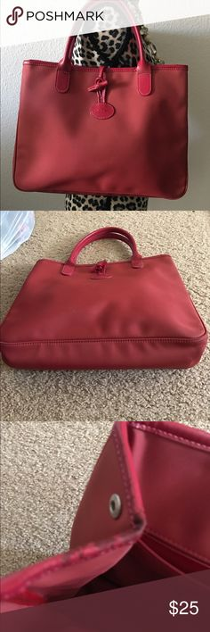 Authentic Longchamp Tote Authentic and well loved Longchamp Tote in Red. Shows wear on the top of this tote. Please see and refer to picture 3 and picture 4. Other than that, it's still a cute pretty purse by Longchamp. Longchamp Bags Totes