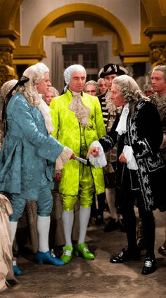 The 18th Century goes Fluoro! More 1970s than 1930s!  George Arliss (far right) - stage and screen actor plays Voltaire in Voltaire, 1933. The Georgian Git in the middle is wearing a frockcoat and breeches sponsored by a Highlight marker manufacturer.