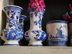 "My grandmother had passed away the winter before I was married, and had a collection of delft. I used a vase just like the one on the left for a memorial arrangement that I put near the guestbook (just the ""guest"" pages from or Hallmark wedding album. I didn't buy a second guestbook)."