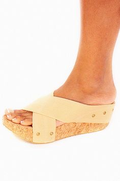 Cassie Sandal In Tan - Casual and comfy in flat wedged sandals. These tan woven strap sandals are made for comfort and easy wear. Just slide them on with virtually any casual outfit. Great to wear with linen pants and shorts for those long days when you just can't seem to get off your feet. Plus they're trendy with the criss-cross straps and simple studded details.  - available online at http://www.envyboutique.us/shop/cassie-sandal-tan/ #Envy #Boutique #chic #fas